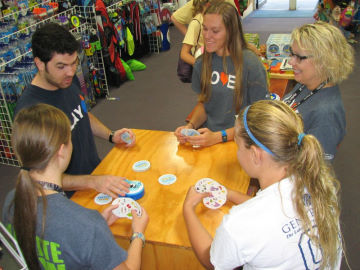 The staff takes time to learn a new game with our Blue Orange rep