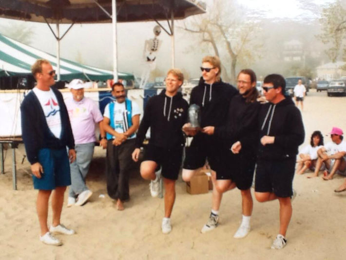 The Roaring Flamingos accept an award at the Great Lakes Stunt Kite Championships