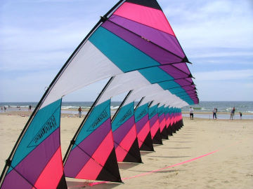 Sam Ritter expertly pilots his huge stack of Revolution kites at the Great Lakes Kite Festival